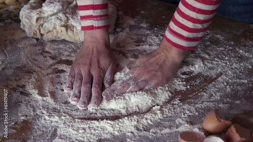 Female hands smoothing flour on table, super slow motion, 240fps