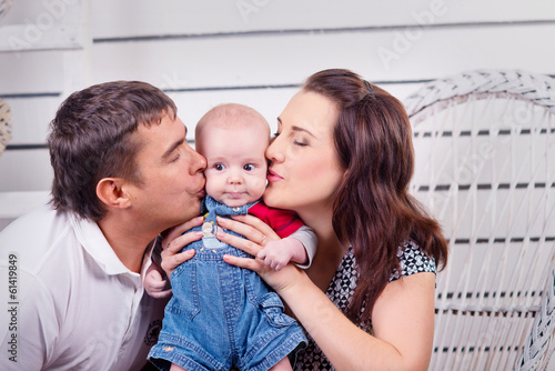Family. Beautiful happy couple with small child.