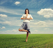 businesswoman standing in yoga pose