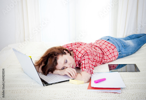 red haired student alseep on laptop while studing