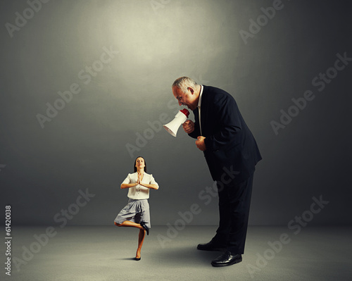 businessman screaming at businesswoman