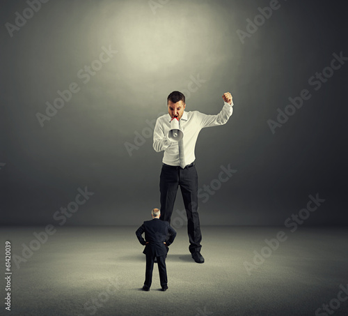 businessman screaming at senior worker