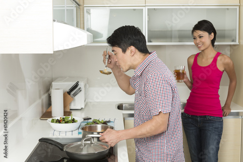 Happy Asian couple together at home
