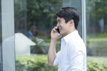 Chinese Business man talking on phone