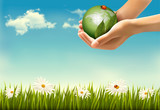 Nature background with hands holding a globe. Vector illustratio