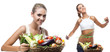 Happy young woman holding basket with vegetable