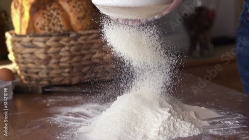 Sifting flour through sieve