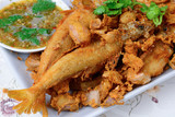 Thai food name is Deep fried Silver banded fish with garlic pepp