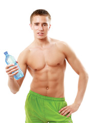 Man drinking water after workout in the gym