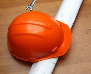 Orange helmet and paper roll