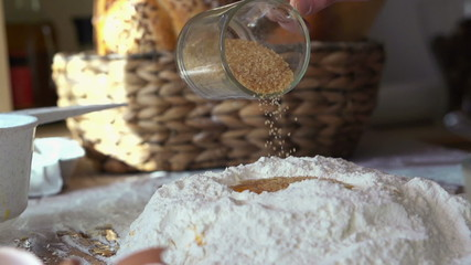 Adding brown sugar to flour and egg