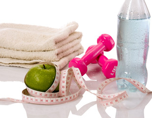 towel, apple and a bottle with water