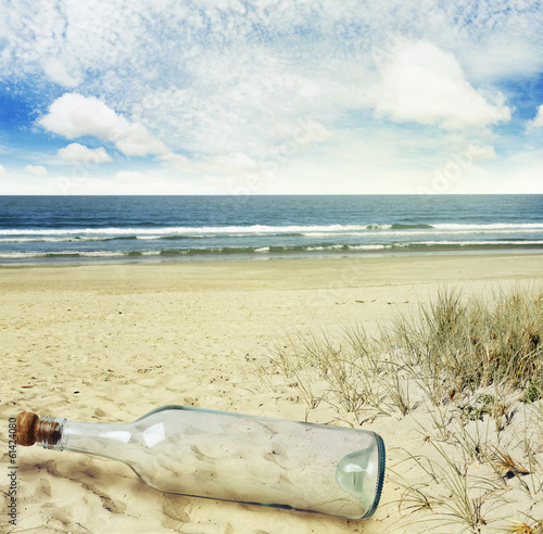 Bottle on sand