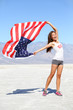 US flag - woman athlete showing american flag USA