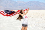 USA flag - woman athlete showing american flag