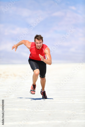 Runner - man running sprinting outdoor