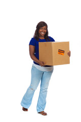 Young African-American female carrying a moving box