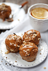 Muffins with caramel frosting and nuts