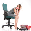 full length of young businesswoman relaxing on the chair