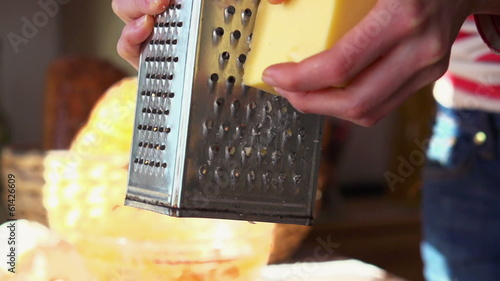 Grate yellow cheese, super slow motion, shot at 240fps