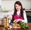 smiling woman cooking with avocado