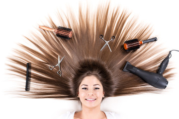 Woman with Beautiful healthy hair and Haircutting Equipment.