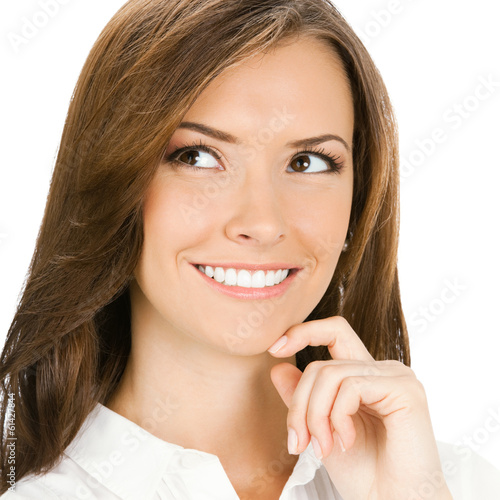 Happy smiling cheerful thinking or planning young business woman