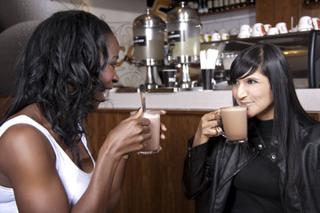 Young Friends enjoy Coffee at a Coffeeshop