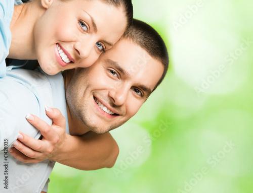 Portrait of happy couple, outdoors
