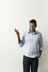 Happy Indian man pointing his finger