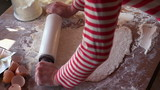 Baker kneading dough with rolling pin, super slow motion,