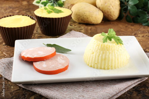 Fresh mashed potatoes, stuffed with sausage and cheese.