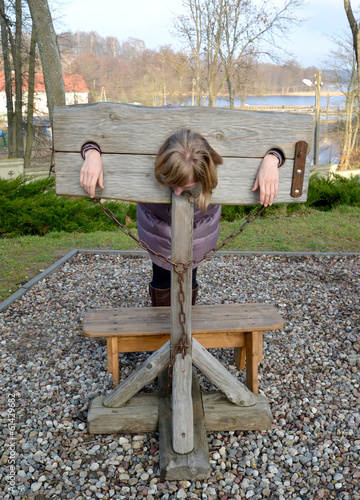 Pillory in the lock Ryn, Poland. Punishment imitation