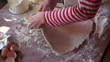 Woman kneading dough with rolling pin, super slow motion,