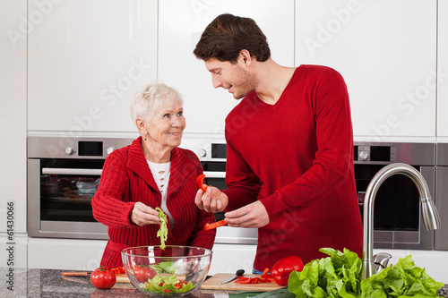Son and mother making salad