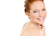 beautiful young redhead woman with freckles portrait on white