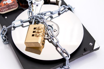 Hard drive disk and padlock. Data security concept.