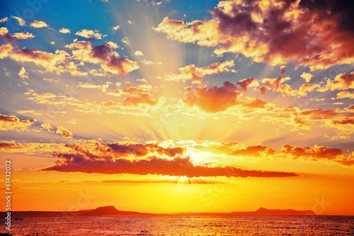 Leinwanddruck Bild Bright colorfull sunset
