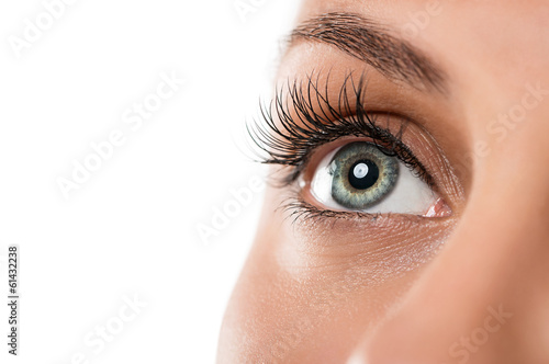 Close up of natural female eye isolated on white background - 61432238