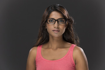 Portrait of stylish Indian Woman wearing glasses.