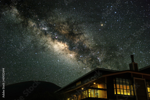 The Milky Way over a mountain house.