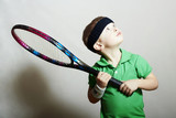 Young Boy Playing Tennis.Sport Children.Child with Tennis Racket
