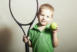 Young Boy Playing Tennis.Sport Children.Tennis Racket and Ball