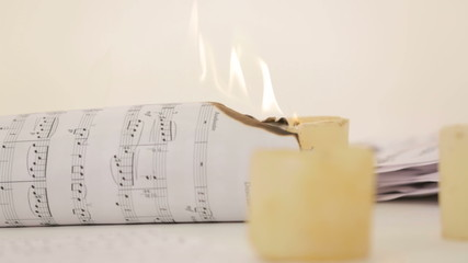 Note sheet on fire. Close-up