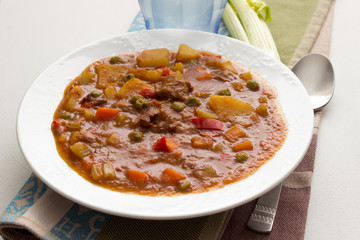 Beef stew with vegetables and herbs