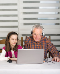 Girl and old man on laptop