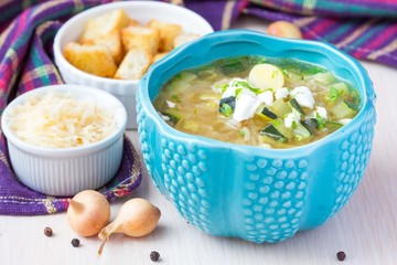 Onion soup with rice, feta cheese, zucchini, croutons, tasty