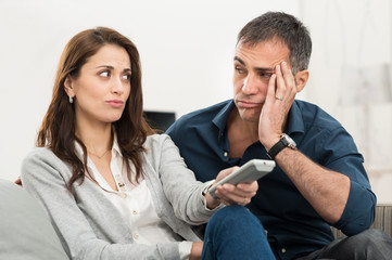 Bored Couple Watching Tv