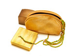 golden and bronze boxes with golden purse and yellow-green bead