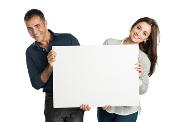 Satisfied Couple Holding A Placard
